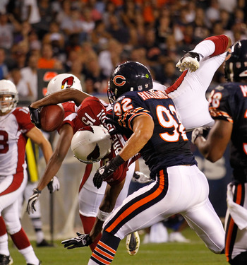 CHICAGO - AUGUST 28: Steve Breaston #15 of the Arizona Cardinals dives in to the end zone for a touchdown as Hunter Hillenmeyer #92 of the Chicago Bears pursues during a preseason game at Soldier Field on August 28, 2010 in Chicago, Illinois. The Cardinal