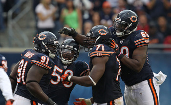 CHICAGO - OCTOBER 24: (L-R) Tommie Harris #91, Rod Wilson #58, Israel Idonije #71 and Henry Melton #69 of the Chicago Bears celebrate a defensive stop against the Washington Redskins at Soldier Field on October 24, 2010 in Chicago, Illinois. The Redskins
