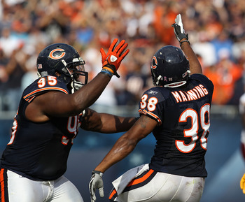 CHICAGO - OCTOBER 24: Danieal Manning #38 and Anthony Adams #95 of the Chicago Bears celebrate Mannings' interception against the Washington Redskins at Soldier Field on October 24, 2010 in Chicago, Illinois. The Redskins defeated the Bears 17-14. (Photo