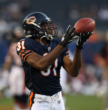 CHICAGO - AUGUST 28: Joshua Moore #31 of the Chicago Bears participates in warm-ups before a preseason game against the Arizona Cardinals at Soldier Field on August 28, 2010 in Chicago, Illinois. The Cardinals defeated the Bears 14-9. (Photo by Jonathan D