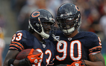CHICAGO - OCTOBER 24: Charles Tillman #33 and Julius Peppers #90 celebrate a take-away by Tillman against the Chicago Bears of the Washington Redskins at Soldier Field on October 24, 2010 in Chicago, Illinois. The Redskins defeated the Bears 17-14. (Photo