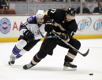 ANAHEIM, CA - OCTOBER 03:  Lubomir Visnovsky #17 of the Anaheim Ducks is chased by Trevor Lewis #61 of the Los Angeles Kings at Honda Center on October 3, 2010 in Anaheim, California.  (Photo by Harry How/Getty Images)