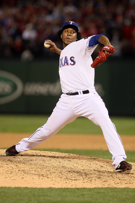 ARLINGTON, TX - OCTOBER 30:  Neftali Feliz #30 of the Texas Rangers pitches against the San Francisco Giants in Game Three of the 2010 MLB World Series at Rangers Ballpark in Arlington on October 30, 2010 in Arlington, Texas.  (Photo by Elsa/Getty Images)