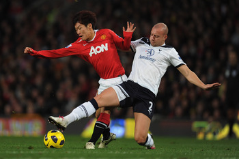 MANCHESTER, ENGLAND - OCTOBER 30: ji-Sung Park of manchester United in action with Alan Hutton of Tottenham during the Barclays Premier League match between Manchester United and Tottenham Hotspur at Old Trafford on October 30, 2010 in Manchester, England