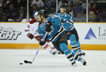 SAN JOSE, CA - SEPTEMBER 25:  Dan Boyle #22 of the San Jose Sharks turns with the puck against the Phoenix Coyotes against the San Jose Sharks in a preseason split-squad game at HP Pavilion on September 25, 2010 in San Jose, California.  The Sharks won 3-