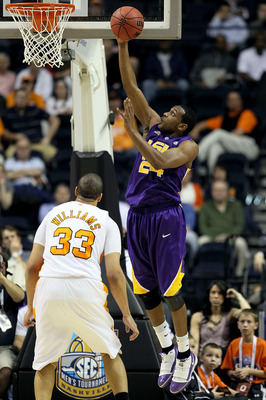 NASHVILLE, TN - MARCH 11:  Storm Warren #24 of the LSU Tigers drives for a shot attempt against Brian Williams #33 of the Tennessee Volunteers during the first round of the SEC Men's Basketball Tournament at the Bridgestone Arena on March 11, 2010 in Nash