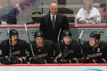 ANAHEIM, CA - OCTOBER 13:  Randy Carlyle, head coach of the Anaheim Ducks looks on from the bench against the Vancouver Canucks during their game at Honda Center on October 13, 2010 in Anaheim, California.  (Photo by Jeff Gross/Getty Images)