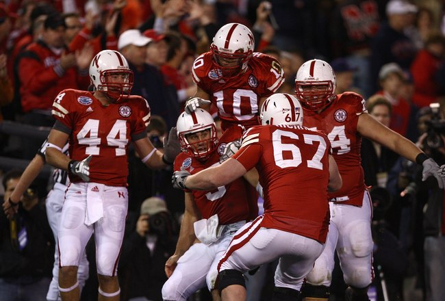 SAN DIEGO - DECEMBER 30:  Quarterback Zac Lee #5 of the University of Nebraska Cornhuskers is mobbed by teammates after scoring the first touchdown against the University of Arizona Wildcats during the Pacific Life Holiday Bowl on December 30, 2009 at Qua