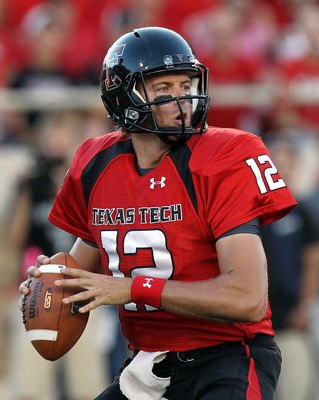 Taylor Potts is setting up to toss the football.  This image focuses on the Red Raiders at home in September 2010.