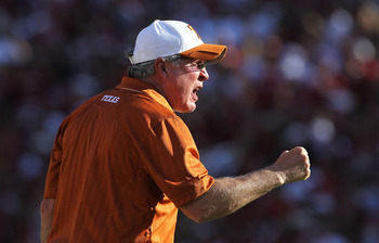 Mack Brown exhorts his troops during the Red River Rivalry.  The camera is showing his intensity in early October 2010.