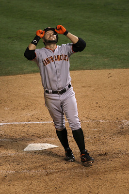 ARLINGTON, TX - OCTOBER 30:  Cody Ross #13 of the San Francisco Giants celebrates his solo home run in the top of the seventh inning against Colby Lewis #48 of (R) the Texas Rangers in Game Three of the 2010 MLB World Series at Rangers Ballpark in Arlingt