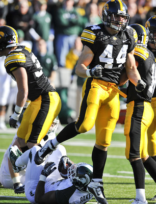 IOWA CITY, IA - OCTOBER 30:  Line backer James Morris #44 of the the University of Iowa Hawkeyes celebrates after tackling running back Edwin Baker #4 of the Michigan State Spartans during the first half of play at Kinnick Stadium on October 30, 2010 in I