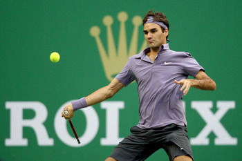 SHANGHAI, CHINA - OCTOBER 17:  Roger Federer of Switzerland returns a shot to Andy Murray of Great Britain during the final on day seven of the 2010 Shanghai Rolex Masters at the Shanghai Qi Zhong Tennis Center on October 17, 2010 in Shanghai, China.  (Ph