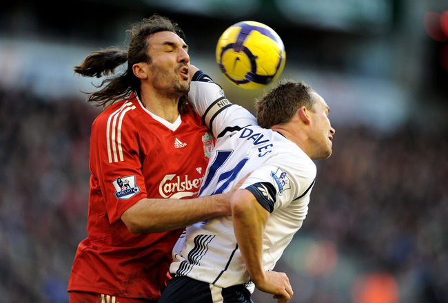 LIVERPOOL, ENGLAND - JANUARY 30: Kevin Davies of Bolton battles with Sotirios Kyrgiakos of Liverpool during the Barclays Premier League match between Liverpool and Bolton Wanderers at Anfield on January 30, 2010 in Liverpool, England.  (Photo by Laurence