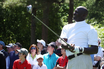 CHARLOTTE, NC - APRIL 28:  Basketball legend Michael Jordan watches a shot during the pro am prior to the start of the 2010 Quail Hollow Championship at the Quail Hollow Club on April 28, 2010 in Charlotte, North Carolina.  (Photo by Scott Halleran/Getty