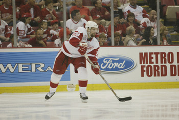 DETROIT, MI - JUNE 13:  Defenseman Steve Duchesne #28 of the Detroit Red Wings skates with the puck against the Carolina Hurricanes during game five of the NHL Stanley Cup Finals on June 13, 2002 at the Joe Louis Arena in Detroit, Michigan.  The Red Wings