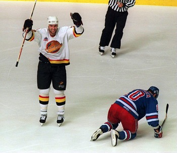 11 Jun 1994: CANUCKS DEFENSEMAN JEFF BROWN CELEBRATES AFTER SCORING TO PUT HIS TEAM UP 1-0 DURING THE FIRST PERIOD OF GAME SIX OF THE STANLEY CUP FINALS AGAINST THE RANGERS IN VANCOUVER, BRITISH COLUMBIA. AT RIGHT IS FALLEN RANGER''S WINGER ESA TIKKANEN.