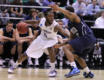 SALT LAKE CITY - MARCH 25:  Jacob Pullen #0 of the Kansas State Wildcats handles the ball under pressure from Terrell Holloway #52 of the Xavier Musketeers during the west regional semifinal of the 2010 NCAA men's basketball tournament at the Energy Solut