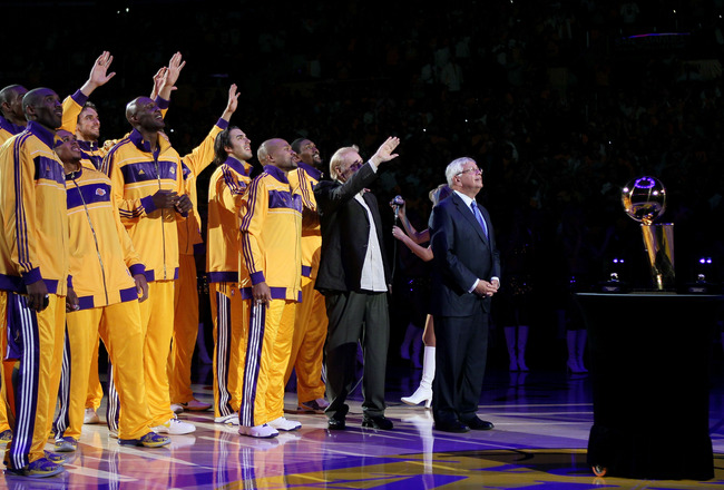 LOS ANGELES, CA - OCTOBER 26:  The Los Angeles Lakers react as the 2009-2010 Championship Banner is unveiled during a ceremony prior to their opening night game against the Houston Rockets at Staples Center on October 26, 2010 in Los Angeles, California.