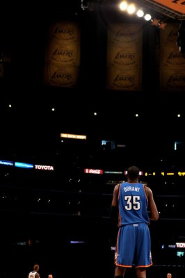 LOS ANGELES, CA - APRIL 18:  Kevin Durant #35 of the Oklahoma City Thunder stands on the court beneath  Los Angeles Lakers banners during  Game One of the Western Conference Quarterfinals of the 2010 NBA Playoffs on April 18, 2010 at Staples Center in Los