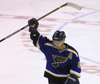 16 Apr 2001: Al MacInnis #2 of the  the St. Louis Blues celebrates a goal against  of the San Jose Sharks during game 3 of the Western Conference Playoff Quarterfinals at the Compaq Center in San Jose , California. DIGITAL IMAGE Mandatory Credit: Tom Hauc