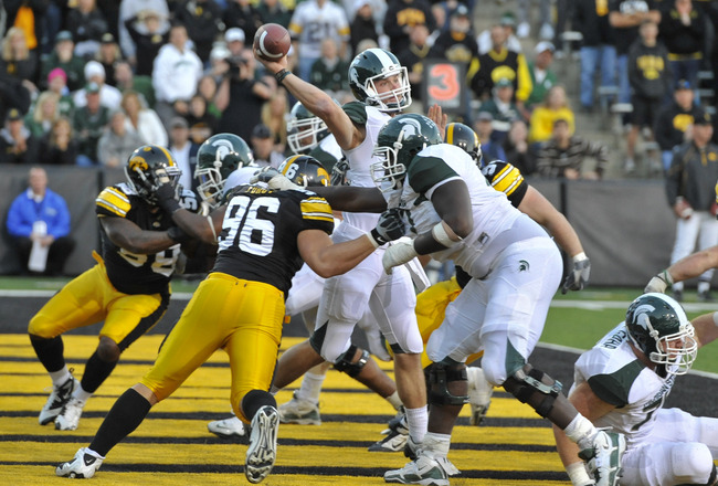 IOWA CITY, IA - OCTOBER 30:  Backup Quarterback Andrew Maxwell #10 of the Michigan State Spartans throws under pressure from Defensive lineman Joe Forgy #96 of the Iowa Hawkeyes during the second half of play at Kinnick Stadium on October 30, 2010 in Iowa