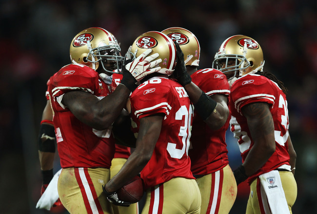 LONDON, ENGLAND - OCTOBER 31:  Shawntae Spencer #36 of San Francisco 49ers is congratulated after an interception during the NFL International Series match between Denver Broncos and San Francisco 49ers at Wembley Stadium on October 31, 2010 in London, En