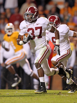 KNOXVILLE, TN - OCTOBER 23:  Robert Lester #37 of the Alabama Crimson Tide runs with the ball after intercepting a pass during the SEC game against the Tennessee Volunteers at Neyland Stadium on October 23, 2010 in Knoxville, Tennessee.  (Photo by Andy Ly