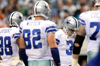 ARLINGTON, TX - OCTOBER 31:  Quarterback Jon Kitna #3 of the Dallas Cowboys stands in the huddle with his head down against the Jacksonville Jaguars at Cowboys Stadium on October 31, 2010 in Arlington, Texas.  (Photo by Chris Chambers/Getty Images)