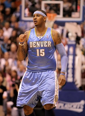 SALT LAKE CITY - APRIL 30:  Carmelo Anthony #15 of the Denver Nuggets pumps his fist during their game against the Utah Jazz in Game Six of the Western Conference Quarterfinals of the 2010 NBA Playoffs at EnergySolutions Arena on April 30, 2010 in Salt La