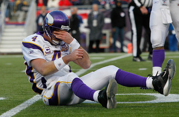 FOXBORO, MA - OCTOBER 31:  Brett Favre #4 of the Minnesota Vikings reacts after being knocked down in the first half against the New England Patriots at Gillette Stadium on October 31, 2010 in Foxboro, Massachusetts. (Photo by Jim Rogash/Getty Images)