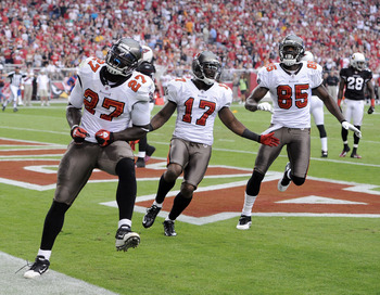 GLENDALE, AZ - OCTOBER 31:  LeGarrette Blount #27 of the Tampa Bay Buccaneers celebrates his touchdown with Arrelious Benn #17 and Maurice Stovall #85 for a 31-14 lead over the Arizona Cardinals during the second quarter at University of Phoenix Stadium o