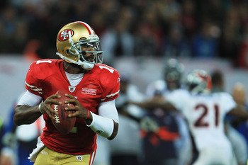 LONDON, ENGLAND - OCTOBER 31:  Troy Smith #1 of San Francisco 49ers looks for a pass during the NFL International Series match between Denver Broncos and San Francisco 49ers at Wembley Stadium on October 31, 2010 in London, England. This is the fourth occ