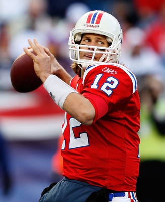 FOXBORO, MA - OCTOBER 31:  Tom Brady #12 of New England Patriots throws against the Minnesota Vikings at Gillette Stadium on October 31, 2010 in Foxboro, Massachusetts. (Photo by Jim Rogash/Getty Images)