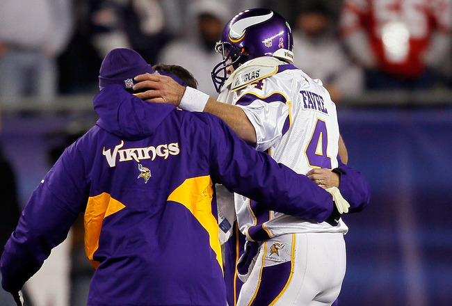 FOXBORO, MA - OCTOBER 31:  Brett Favre #4 of the Minnesota Vikings is helped to the bench after he was hit by Myron Pryor #91 of the New England Patriots in the fourth quarter at Gillette Stadium on October 31, 2010 in Foxboro, Massachusetts. Favre was in