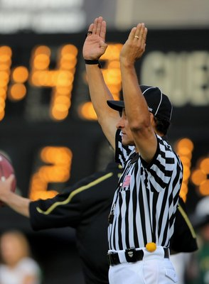 BOULDER, CO - SEPTEMBER 06:  Officials signal a field goal as the Colorado State Rams face the Colorado Buffaloes at Folsom Field on September 6, 2009 in Boulder, Colorado. The Rams defeated the Buffaloes 23-17.  (Photo by Doug Pensinger/Getty Images)