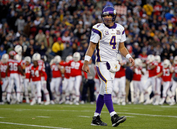 FOXBORO, MA - OCTOBER 31:  Brett Favre #4 of the Minnesota Vikings walks off the field after a missed opportunity against the New England Patriots at Gillette Stadium on October 31, 2010 in Foxboro, Massachusetts. (Photo by Jim Rogash/Getty Images)