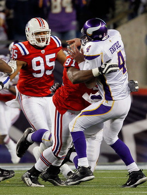 FOXBORO, MA - OCTOBER 31:  Brett Favre #4 of the Minnesota Vikings is hit by defensive tackle Myron Pryor #91 of the New England Patriots in the fourth quarter against the New England Patriots at Gillette Stadium on October 31, 2010 in Foxboro, Massachuse