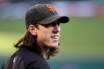 ARLINGTON, TX - OCTOBER 31:  Tim Lincecum #55 of the San Francisco Giants looks on during batting practice against the Texas Rangers in Game Four of the 2010 MLB World Series at Rangers Ballpark in Arlington on October 31, 2010 in Arlington, Texas.  (Phot