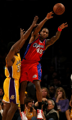LOS ANGELES, CA - JANUARY 15:  Rasual Butler #45 of the Los Angeles Clippers passes the ball against Ron Artest #37 of the Los Angeles Lakers during the game on January 15, 2010 at Staples Center in Los Angeles, California. The Lakers won 126-86. NOTE TO