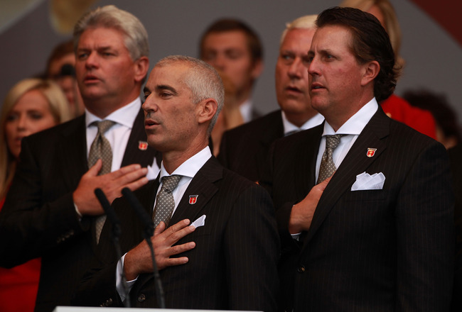 NEWPORT, WALES - SEPTEMBER 30:  USA Team Captain Corey Pavin and Phil Mickelson (R) stand for their national anthem during the Opening Ceremony prior to the 2010 Ryder Cup at the Celtic Manor Resort on September 30, 2010 in Newport, Wales.  (Photo by Andr
