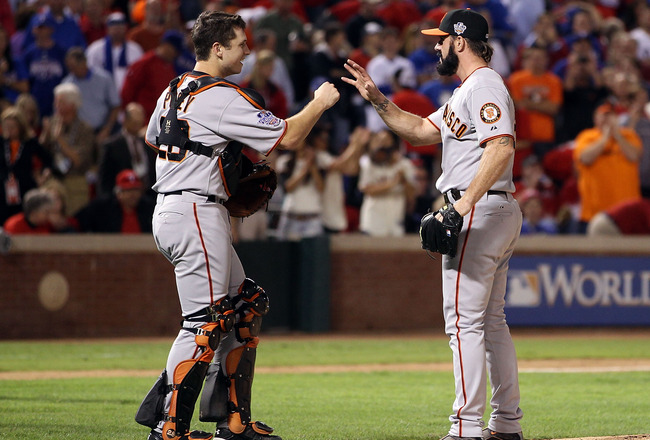 ARLINGTON, TX - OCTOBER 31:  (L-R) Catcher Buster Posey #28 and closing pitcher Brian WIlson #38 of the San Francisco Giants celebrate after their 4-0 win against the Texas Rangers in Game Four of the 2010 MLB World Series at Rangers Ballpark in Arlington