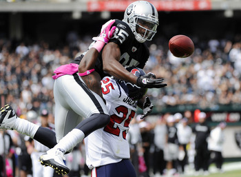 OAKLAND, CA - OCTOBER 3: Defensive Back Kareem Jackson #25 of the Houston Texans breaks up a pass in the endzone to wide receiver Darrius Heyward-Bey #85 of the Oakland Raiders during an NFL football game October 3, 2010 at The Oakland-Alameda County Coli