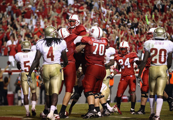 RALEIGH, NC - OCTOBER 28:  Russell Wilson #16 of the North Carolina State Wolfpack celebrates after scoring a touchdown against the Florida State Seminoles during their game at Carter-Finley Stadium on October 28, 2010 in Raleigh, North Carolina.  (Photo