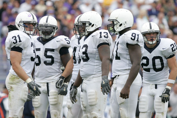 EVANSTON, IL - SEPTEMBER 24:  Linebacker Paul Posluszny #31 of the Penn State Nittany Lions looks to the sidelines for a play call as he hudles up the defense against the Northwestern Wildcats on September 24, 2005 at Ryan Field in Evanston, Illinois. Pen