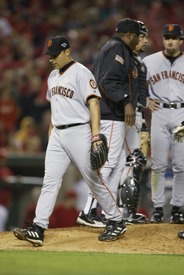 ANAHEIM, CA - OCTOBER 26:  Starting pitcher Russ Ortiz #48 of the San Francisco Giants is pulled by manager Dusty Baker in the fifth inning of game six of the World Series on October 26, 2002 at Edison Field in Anaheim, California. The Angels went on to w