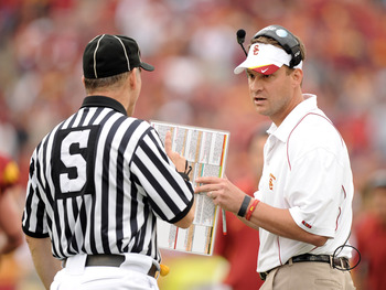 LOS ANGELES, CA - OCTOBER 16:  Head Coach Lane Kiffin of the USC Trojans argues a call with an official against the California Golden Bears at Los Angeles Memorial Coliseum on October 16, 2010 in Los Angeles, California.  (Photo by Harry How/Getty Images)