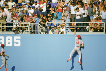 LOS ANGELES - OCTOBER 16: Andy Van Slyke #18 of the St. Louis Cardinals reaches for the catch against the Los Angeles Dodgers during Game 6 of the National League Championship Series on October 16, 1985 at Dodger Stadium in Los Angeles, California. (Photo