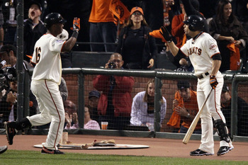 SAN FRANCISCO - OCTOBER 28:  (L-R) Edgar Renteria #16 of the San Francisco Giants is greeted by Andres Torres #56 after Renteria hits a fifth inning solo home run off of C.J. Wilson #36 of the Texas Rangers in Game Two of the 2010 MLB World Series at AT&T