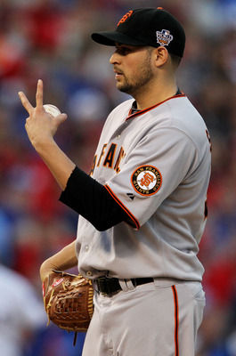 ARLINGTON, TX - OCTOBER 30:  Starting pitcher Jonathan Sanchez #57 of the San Francisco Giants gestures towards home plate against the Texas Rangers in Game Three of the 2010 MLB World Series at Rangers Ballpark in Arlington on October 30, 2010 in Arlingt